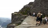 PULPIT ROCK, NORWAY - CIRCA JULY 2010. Visitors move along the trail to the cliff. Editorial use!