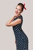 Portrait Of Smiling Pin Up Woman In Polka Dot Dress. Cute Girl In Retro Style poster