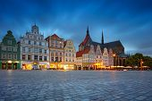 Rostock, Germany. Cityscape Image Of Rostock, Germany During Twilight Blue Hour. poster