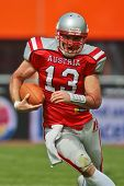 VIENNA, AUSTRIA - JULY 15: QB Thomas Haider (#13 Austria) runs with the ball at the Football World C