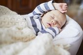 Adorable Baby Girl Sleeping In The Crib. Little Child Having A Day Nap In Cot. Infant Kid Resting In poster