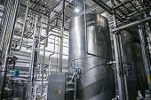 Stainless Steel Brewing Equipment, Iron Reservoirs Or Tanks And Pipes In Modern Beer Factory. Brewer poster