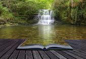 Creative Concept Image Of Flowing Forest Waterfall Coming Out Of Pages In Magical Book