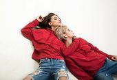 Youth Fashion. Feeling Free And Stylish. Couple Women Wear Modern Clothes For Youth Generation. Fore poster