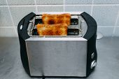 Healthy Fashion Food Of Breakfast. Toast In A Toaster. Toaster With Tasty Breakfast Toasts On The Ta poster