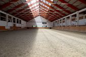 Picture Of An Empty Indoor Horse Riding Hall. Horizontal View In An Indoor Riding Arena poster