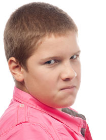 stock photo of spoiled brat  - Angry teenage boy looking with hate in his eyes - JPG