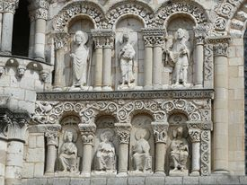 picture of poitiers  - Carved figures on the exterior of a Romanesque church in Poitiers - JPG