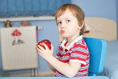 Little Boy Eating An Apple