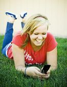 Girl Smiling At Text Message