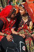 Pushkar, India - November 21: Rajasthani Young Women  Are Preparing To Dance  At Camel Fair Holiday