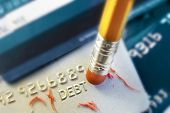 image of pencil eraser  - closeup of a pencil erasing credit card debt
