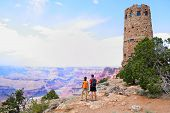 Grand Canyon people hiking. Hiker couple enoying view. Indian Desert View Watchtower, south rim of G