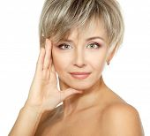 mid adult woman portrait, face of attractive caucasian middle 40 years old woman over white