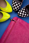Colorful high heels and snakeskin print bag