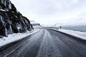 foto of fjord  - Open frozen roads in icelands east fjords in mid winter - JPG