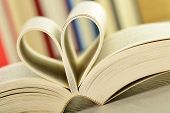 stock photo of poetry  - Composition with books and pages in a formed in a shape of heart - JPG