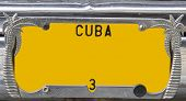 Closeup of a yellow vintage numberplate on Cuba