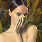 stock photo of mehendi  - Beautiful young lady with painted hands mehendi - JPG