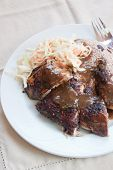 stock photo of jerks  - Caribbean style jerk chicken served with rice mixed with red kidney beans - JPG