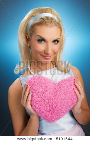poster of Beautiful Young Woman With Fluffy Heart Pillow