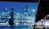 Brooklyn bridge and Manhattan in New York at night
