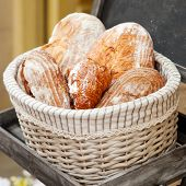 picture of bakeshop  - crispy wholemeal bread in a basket closeup - JPG