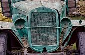 Old Abandoned Rusted Truck With Empty Headlamps