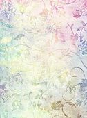 Abstract textured background: blue, brown, and red floral patterns on yellow backdrop. For art textu