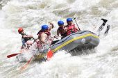 picture of raft  - Rafting splashing the white water - JPG