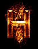 h, illustration of  letter with chrome effects and red fire on black background