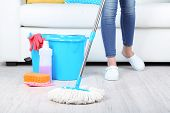 stock photo of housekeeper  - Cleaning floor in room close - JPG