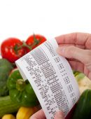 stock photo of receipt  - A Receipt over bag full of vegetables including tomatoes - JPG
