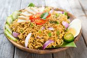 Malaysian style maggi goreng mamak  or spicy fried curry instant noodles.  Asian cuisine, ready to s