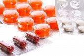 Medical pills over white background