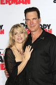 LOS ANGELES - MAR 5: Patrick Warburton, wife at the premiere of 'Mr. Peabody & Sherman' at Regency V