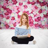 education, technology and internet concept - little student girl with tablet pc