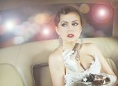 pic of superstars  - Young and beautiful celebrity woman sitting in a luxury car and eating a chocolate - JPG