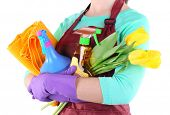 Housewife holding cleaning equipment in her hands. Conceptual photo of spring cleaning. Isolated on