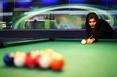 image of snooker  - Young brunette girl playing snooker - JPG