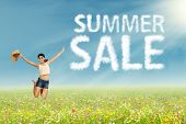 Girl Jumping With Summer Sale Sign