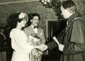LODZ, POLAND, CIRCA SIXTIES - Vintage photo of newlyweds during civil marriage ceremony