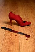 bloody knife with high heel shoe