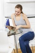 Woman using tablet in the kitchen