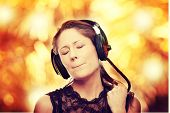 Listening to the Music, young caucasian beautiful woman with headphones, isolated on white backgroun