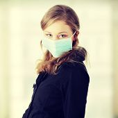 A model wearing a mask to prevent 'Swine Flu' infection.