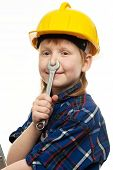 Little boy in protective helmet  having fun with wrench tool