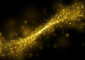 Gold glittering stars dust trail background