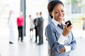happy african american career woman using cell phone