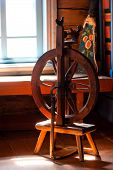 Wooden Spinning Installation In A Cottage